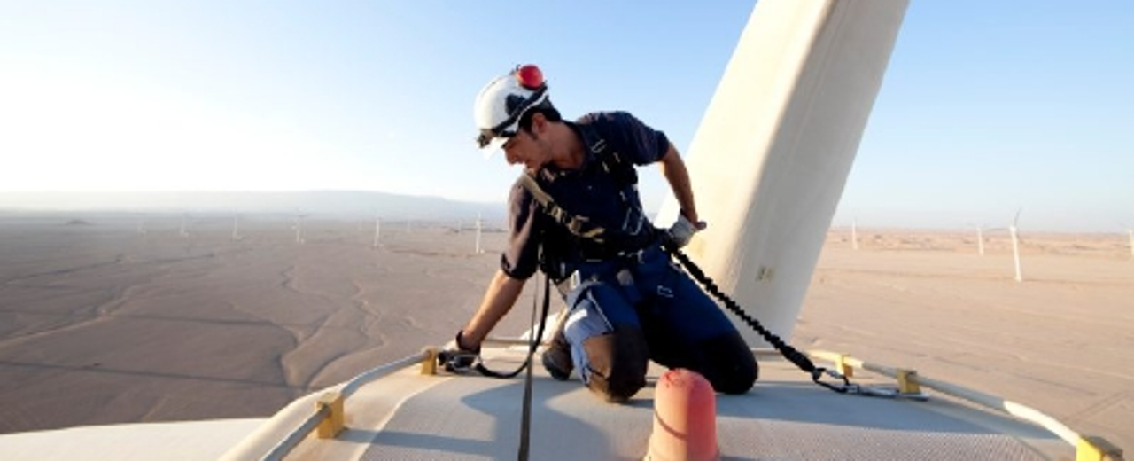 Egyptian engineer checks wind turbine