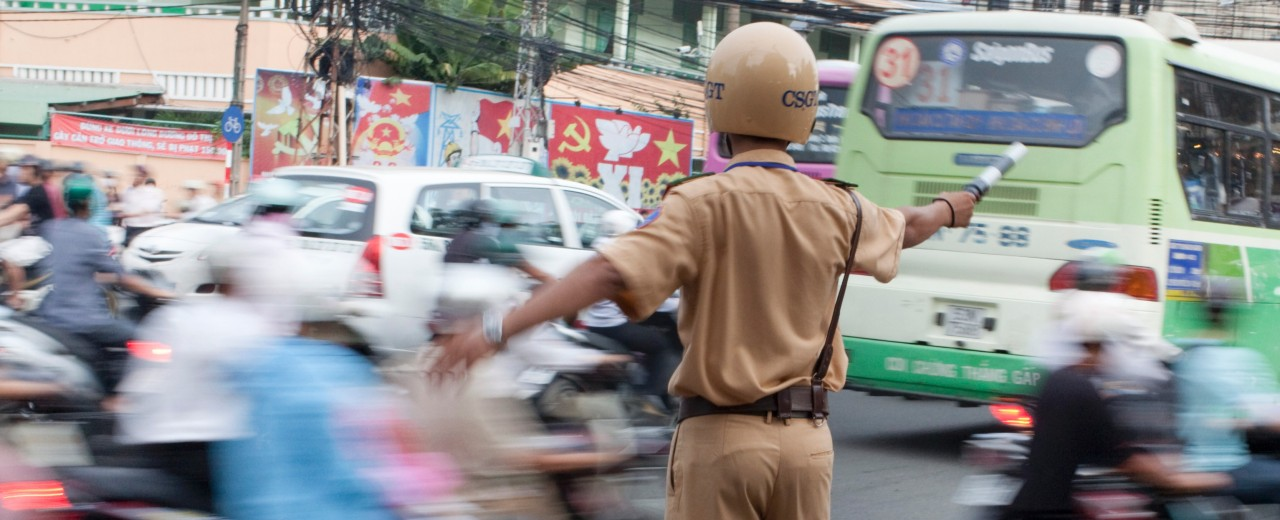 Police man directs traffic in Vietnam
