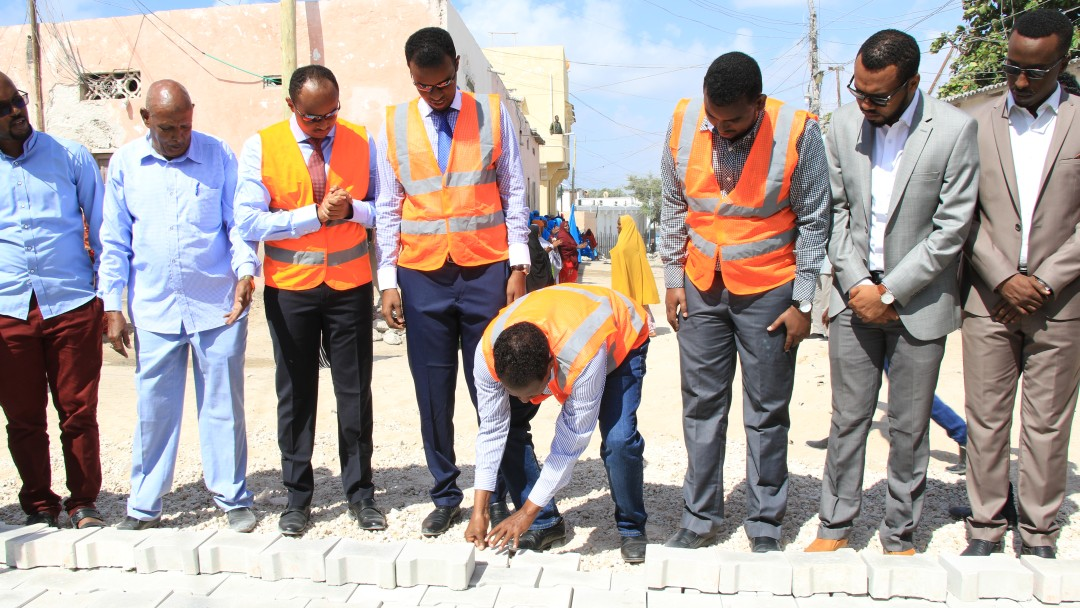 In Mogadischu the first model stones are put into place for a road building programme.