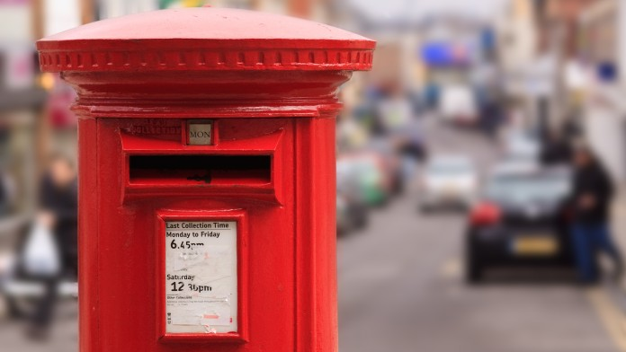 red english mailbox, city in the backround