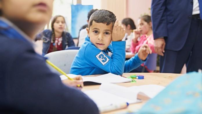 young boy in school