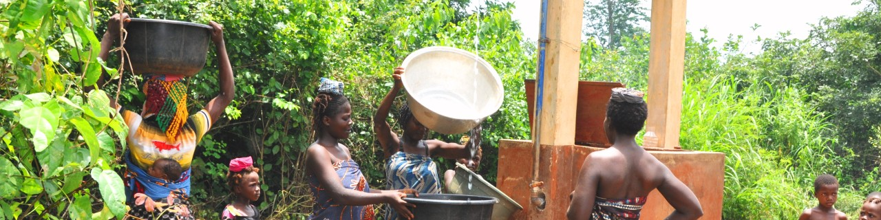 Residents fetch water from the well