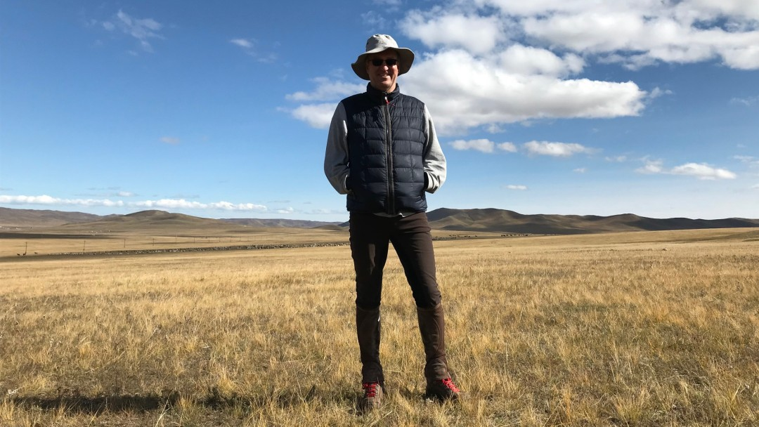 Office director in landscape of Mongolia