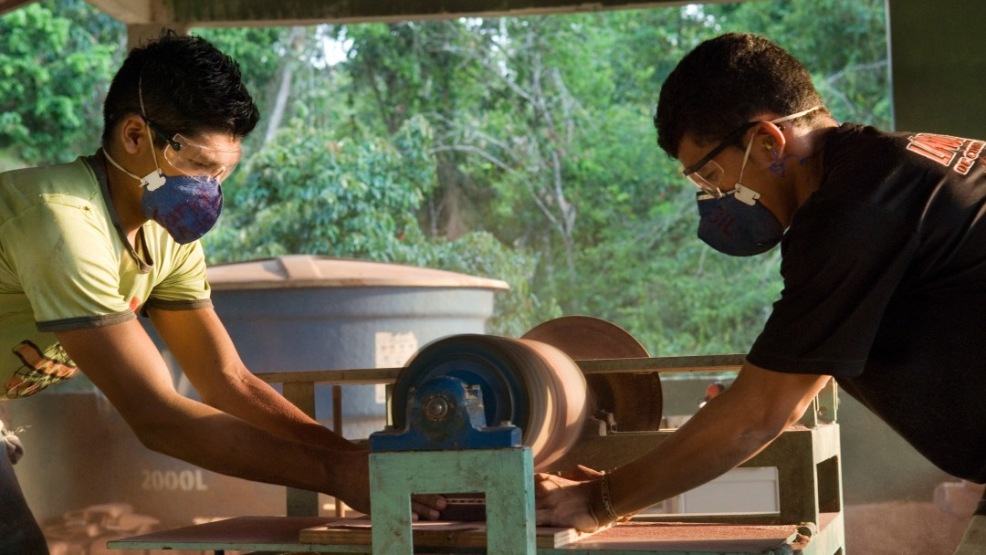 Two young men making handicrafts