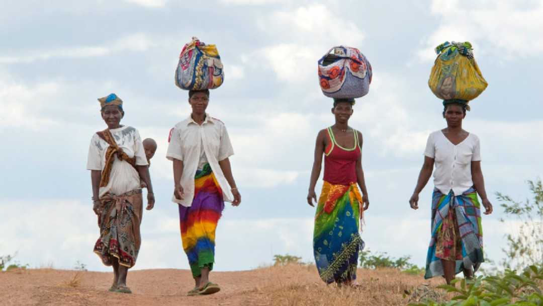 Women with products on their heads on their way to a market.