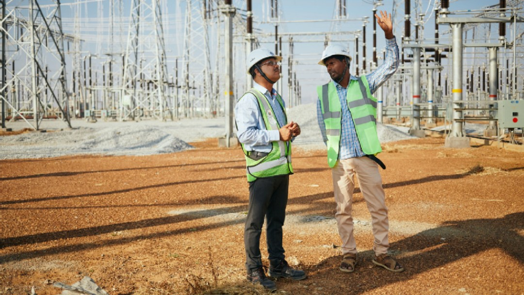Two men on the site of a transformer station