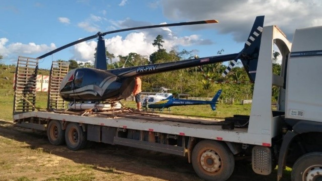 confiscated helicopter is towed away