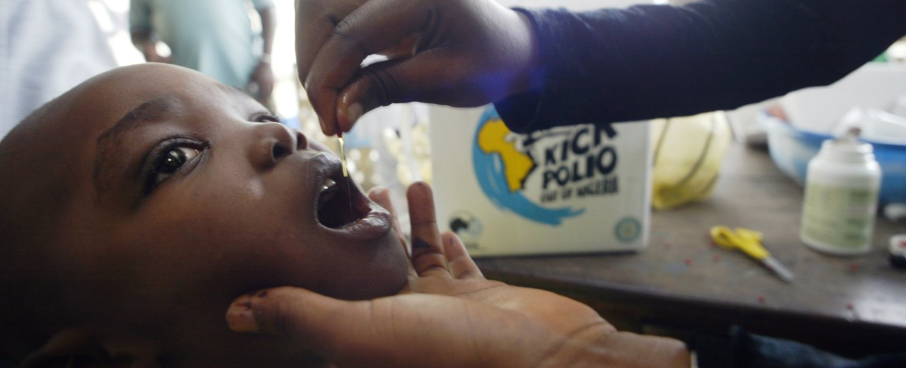 A child receives a vaccination against polio