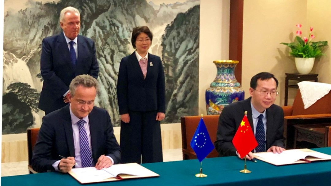 Signing the agreement in Beijing.
