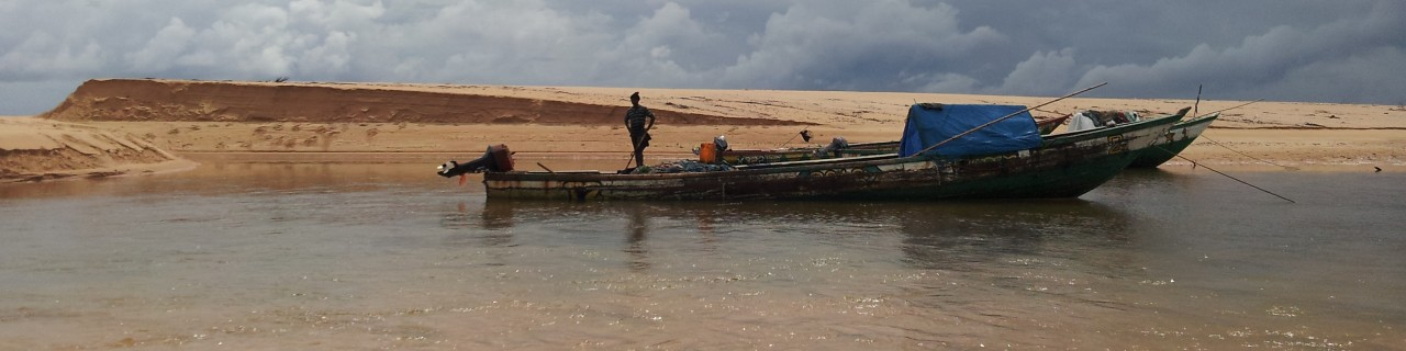 Fishing boat in shallow water at the beach of Sierra Leone.
