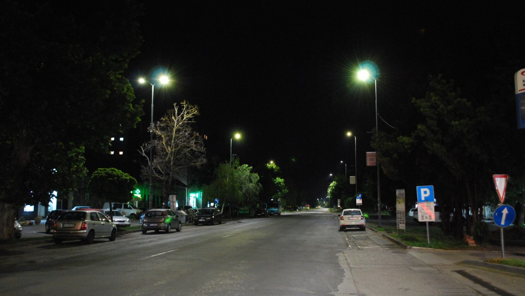 A street illuminated by LED street lamps at night.
