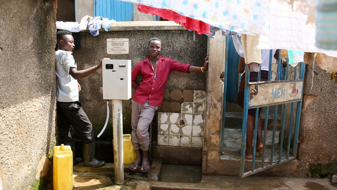 two men are lined up to fetch water