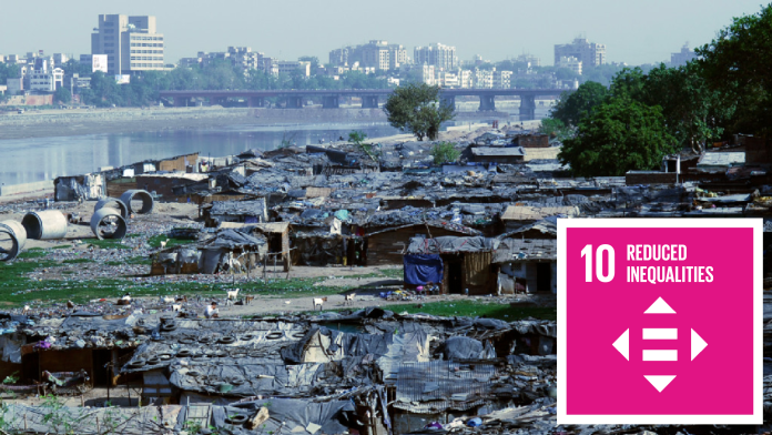 Slums, in the background skyscrapers, next to SDG 10 Icon: Reduced inequalities