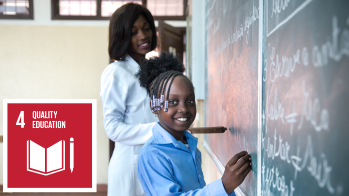 A girl is smiling and writes something on the blackboard, next to it is the icon of SDG 4: quality education