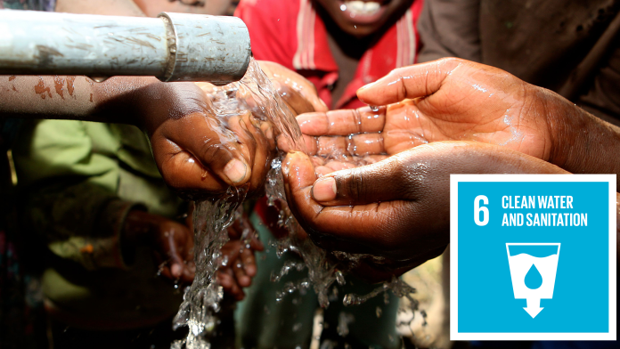 Hands being washed, next to it: the Icon of SDG 6: clean water and sanitation