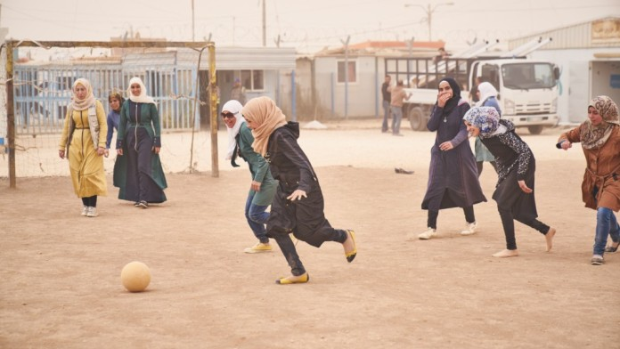 Girls play soccer in the UNICEF-Makani Center for training and non-formal education in a refugee camp in Jordan.